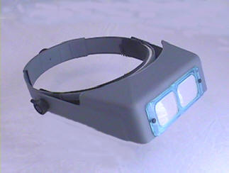 Optivisor is shown with clear glass lens. Clear glass lenses come with blue frame.